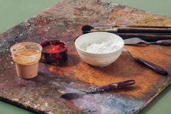 Paint brushes and oil paints royalty free stock photo