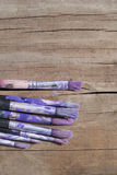 Paint brushes on an old board Stock Photos