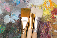 Paint brushes and old pallet Royalty Free Stock Photos