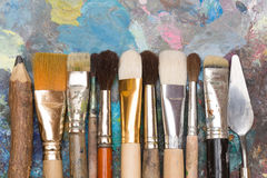 Paint brushes and old pallet Stock Photography