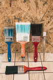 Paint brushes on the old tile background Stock Images