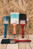 Paint brushes on the old tile background Royalty Free Stock Photo