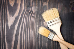 Paint brushes on old wooden background Royalty Free Stock Images