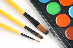 Paint brushes and paint Stock Photography