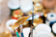 Paint brushes in a painting workshop. With a colorful background inspiring creation royalty free stock images