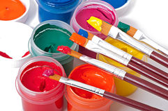 Paint brushes and paints Stock Images