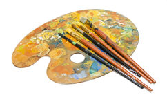 Paint brushes on a palette Stock Images