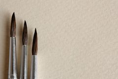 Paint brushes on papers background Royalty Free Stock Photography