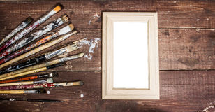 Paint brushes and photo frame Royalty Free Stock Images