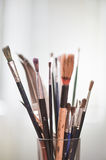 Paint brushes in the pot. All kinds of brushes Stock Photos