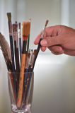 Paint brushes in the pot. All kinds of brushes Royalty Free Stock Photography
