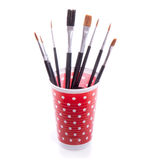 Paint brushes in a red dotted cup Stock Photography