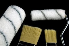 Paint Brushes and Rollers on a Black Background Stock Image