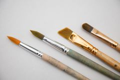 Paint brushes. Some natural assorted paint brushes stock photo