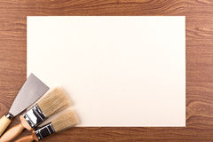 Paint brushes and a spatula. Royalty Free Stock Image