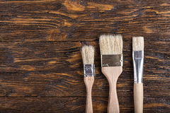Paint brushes on the table, top view Royalty Free Stock Image