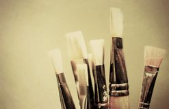 Paint brushes with texture applied and cross proce Stock Photography