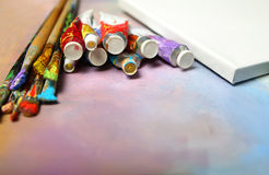 Paint brushes and tubes of oil paint Stock Photo