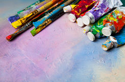 Paint brushes and tubes of oil paint Stock Photos