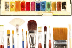 Paint brushes and the water colors Stock Photos