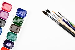 Paint brushes and watercolor paints on a white background.  royalty free stock photo