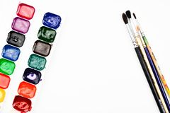 Paint brushes and watercolor paints on a white background.  royalty free stock image