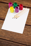 Paint brushes, watercolor paints and white paper Royalty Free Stock Photos