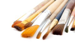 Paint brushes on a white background. Stock Photos