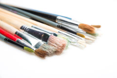 Paint brushes on white background with selective focus Royalty Free Stock Photo