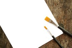Paint brushes and white paper Royalty Free Stock Image