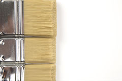 Paint brushes on white paper Royalty Free Stock Photography
