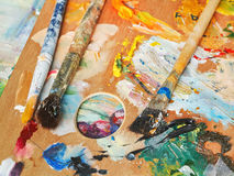 Paint brushes on wood artistic pallette Royalty Free Stock Image