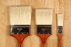 Paint Brushes on Wood Surface Stock Images