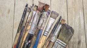 Paint Brushes. On wooden background Stock Images