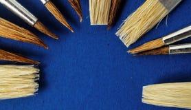 Paint brushes on wooden background, digital photo picture as a background. Paint brushes on wooden background, beautiful photo digital picture royalty free stock photo