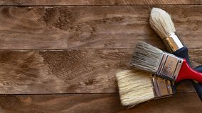 Paint brushes on a wooden table stock photo