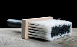 Paint brushes on a wooden table Royalty Free Stock Photos