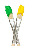 Paint brushes with yellow and green paints Royalty Free Stock Photo