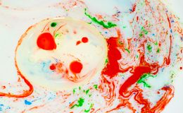 Paint bubbles in liquid. Ink in water  on white background Royalty Free Stock Photo