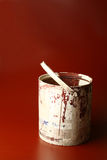 Paint Bucket. Brownish red paint in an old used bucket Stock Photography