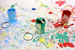 Paint bucket and brush. The paint bucket and brush are on the board stock photo