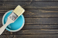 Paint bucket and brush on table. Paint bucket and brush on wooden table Stock Images