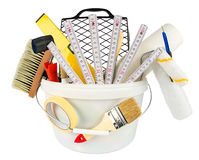 Paint bucket filled with renovation tools. Paint bucket filled with renovation decoration diy tools isolated on white background royalty free stock image