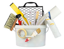 Paint bucket filled with renovation tools royalty free stock photography