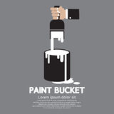 Paint Bucket With Paintbrush In Hand Stock Image