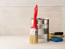 Paint bucket and paintbrush  on wood Royalty Free Stock Photo