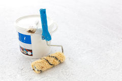 Paint bucket with roller brush on white. Royalty Free Stock Images