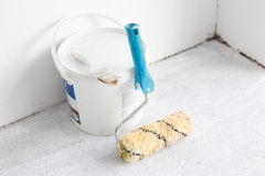 Paint bucket with roller brush on white. Stock Photography