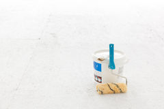 Paint bucket with roller brush on white. Royalty Free Stock Photo