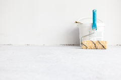Paint bucket with roller brush on white. Stock Images